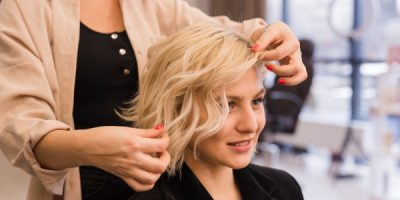 blonde-woman-getting-her-hair-done